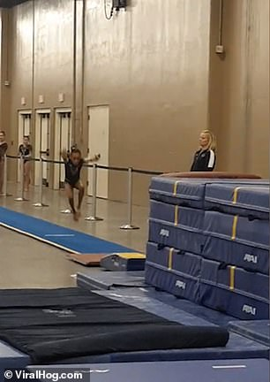 The girl approaches the springboard in her first attempt