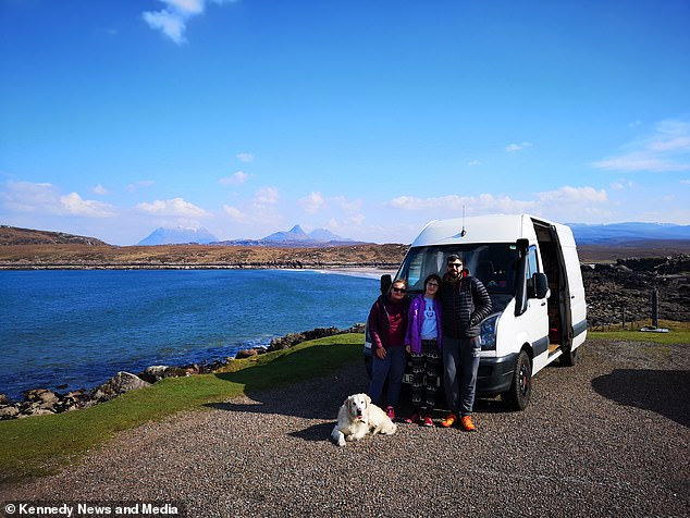 Robert Bambach, 40, and wife Renata, 42, quit their high-pressure jobs in London to live in a van with their daughter Ricarda and their dog Charlie. Pictured, the family near Glencoe, Scotland, during the nine months they spent travelling the UK last year