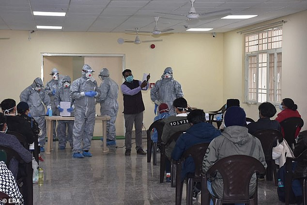 Officials wearing protective suits at a quarantine facility in New Delhi. A group of 76 Indians and 36 foreign nationals, including eight families with children, were evacuated from Wuhan, the epicenter of the outbreak