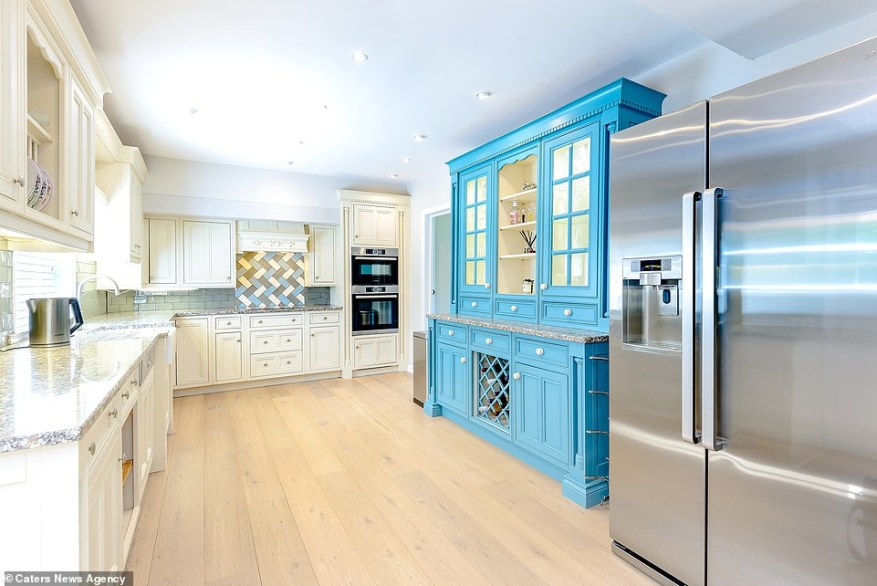 The ground floor boasts a spacious kitchen (pictured) which comes fitted with Bosch integrated appliances, granite worktops and a Belfast style sink