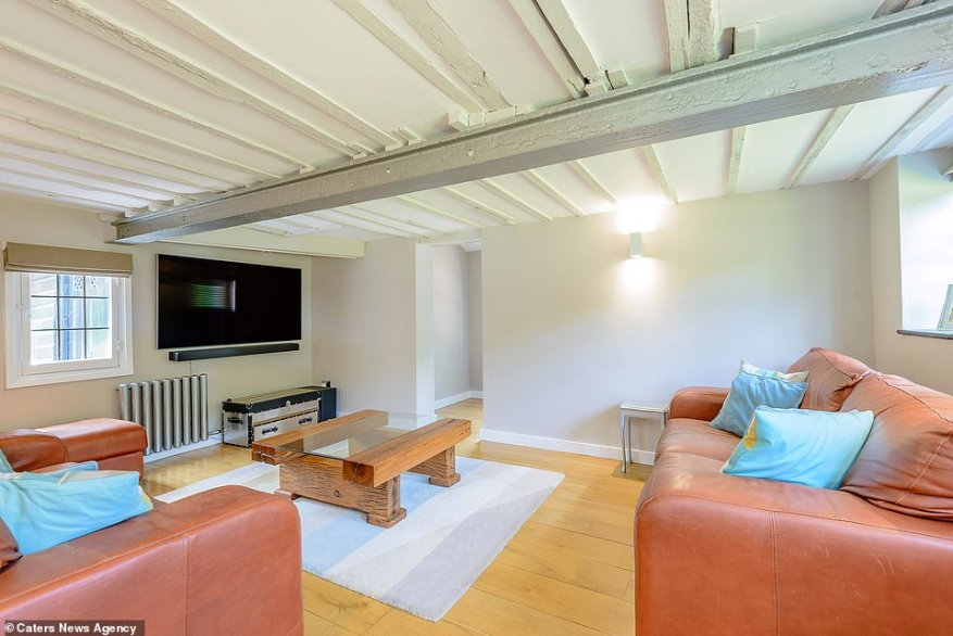 The four-bedroom house was built more than three centuries ago but has recently undergone a 21st-century revamp. Pictured: The snug