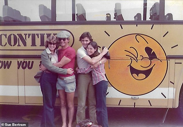 Cuddles: Sue Bertram (left) and her best friend Jill with the Contiki trip manager and Contiki driver