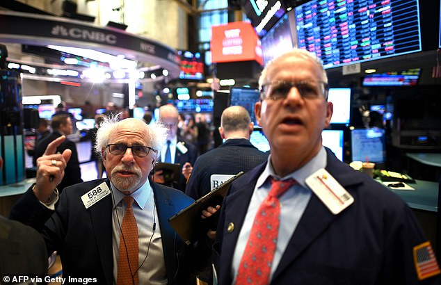 By the end of play on Thursday, Wall Street's Dow Jones index had suffered its greatest losses in history (pictured traders at the opening bell on Friday)