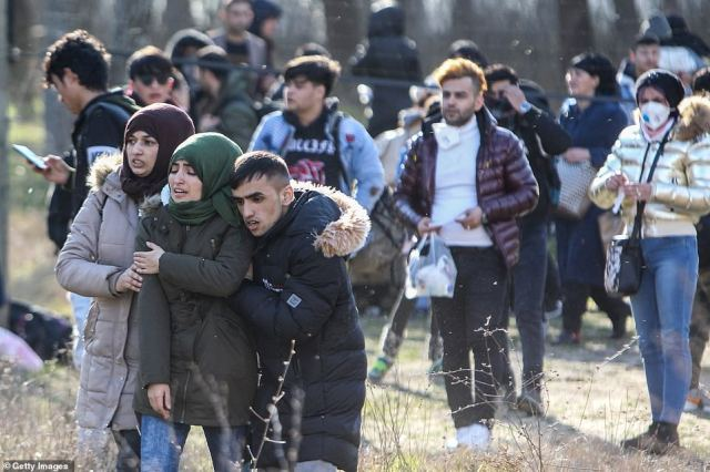 Refugees coming from Turkey walk through the Greek border as they try to cross Greek and Turkish border on February 28, in Edirne, Turkey