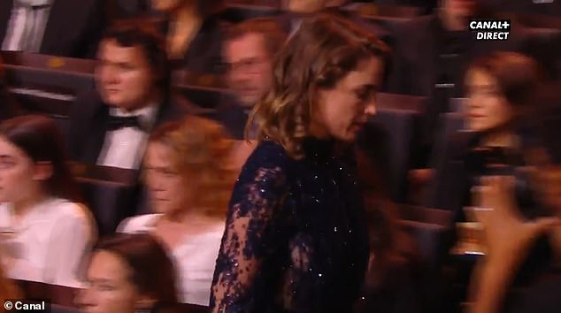 Actress Adele Haenel, who recently denounced alleged sexual assault by another French director in the early 2000s when she was 15, got up and walked out of the room, followed by a few others