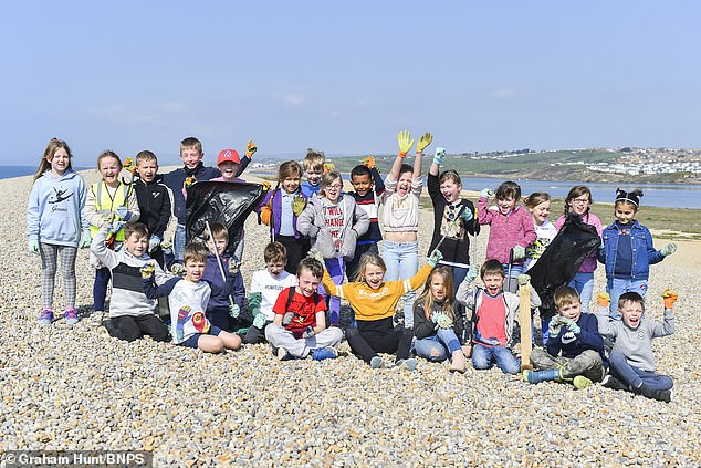 We're the young generation: Pupils from Damers First School near Dorchester pick up litter on Chesil Beach in Dorset for the Great British Spring Clean.There are 428,720 volunteers partaking in the annual clean and20,000 so-called Eco-Schools registered throughout the country