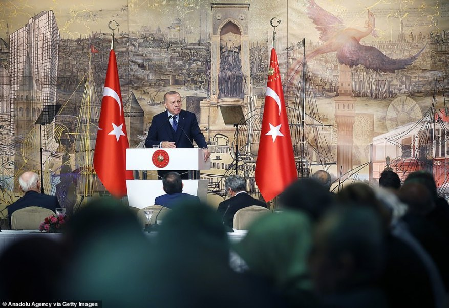 Turkish President Recep Tayyip Erdogan (rear C) makes a speech as he holds a meeting with his ruling Justice and Development (AK) Party's Istanbul deputies at the Dolmabahce Palace in Istanbul, Turkey today