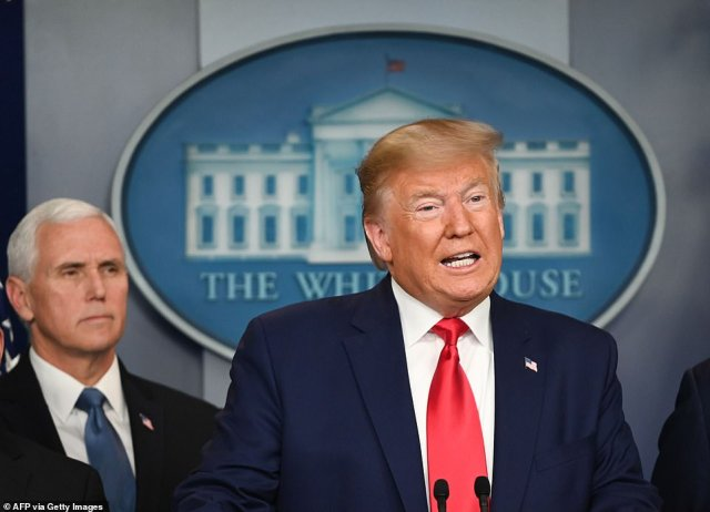 US President Donald Trump speaks during a press conference on the COVID-19, coronavirus, outbreak as US Vice President Mike Pence looks on at the White House