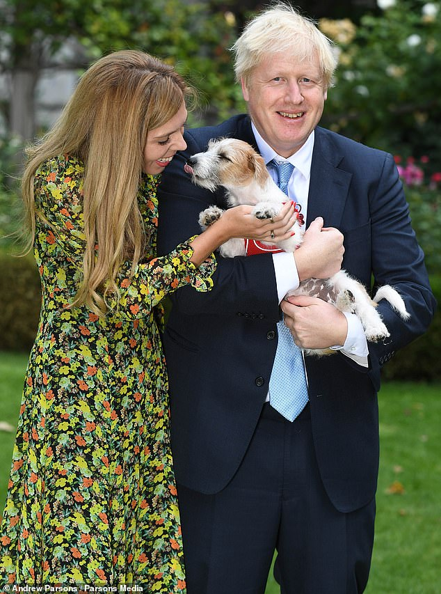 AND DILYN MAKES THREE: The couple welcome the adorable Jack Russell cross – a rescue dog – into No 10 last September