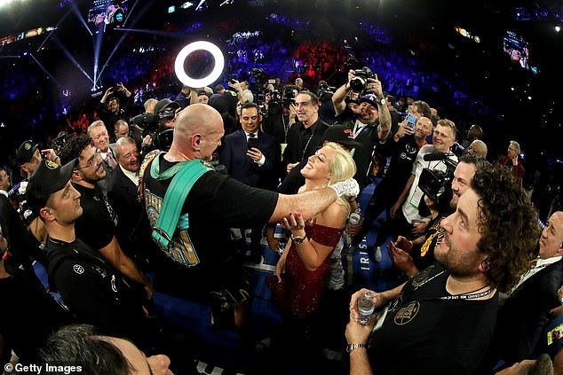 Paris was present as Tyson sang to the crowd after winning back a version of the world title