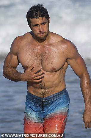 Summer girl: actor Ethan Browne proudly displayed his bulging biceps and broad shoulders while shirtless for the scene