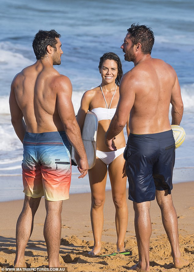 Genetically blessed trio: in another beach scene, Emily was seen talking to hunky co-stars Ethan Browne and Rob Kipa-Williams, who dressed in surf shorts