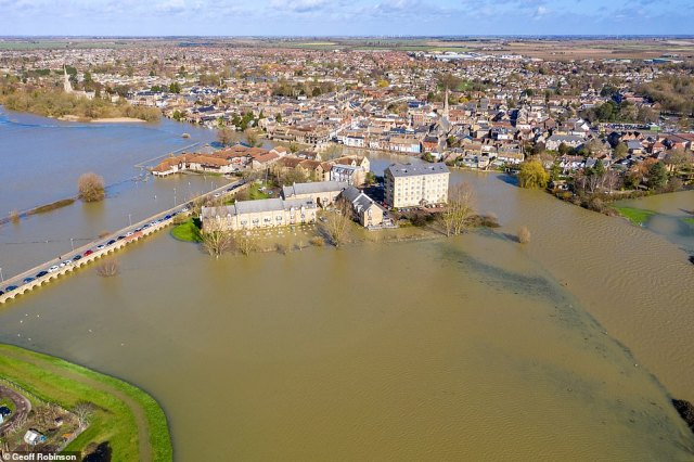 East Riding of Yorkshire Council said water levels are generally dropping or remaining stable in Snaith, Gowdall, East Cowick and West Cowick, but are expected to remain high for several days. Pictured is St Ives in Cambridgeshire