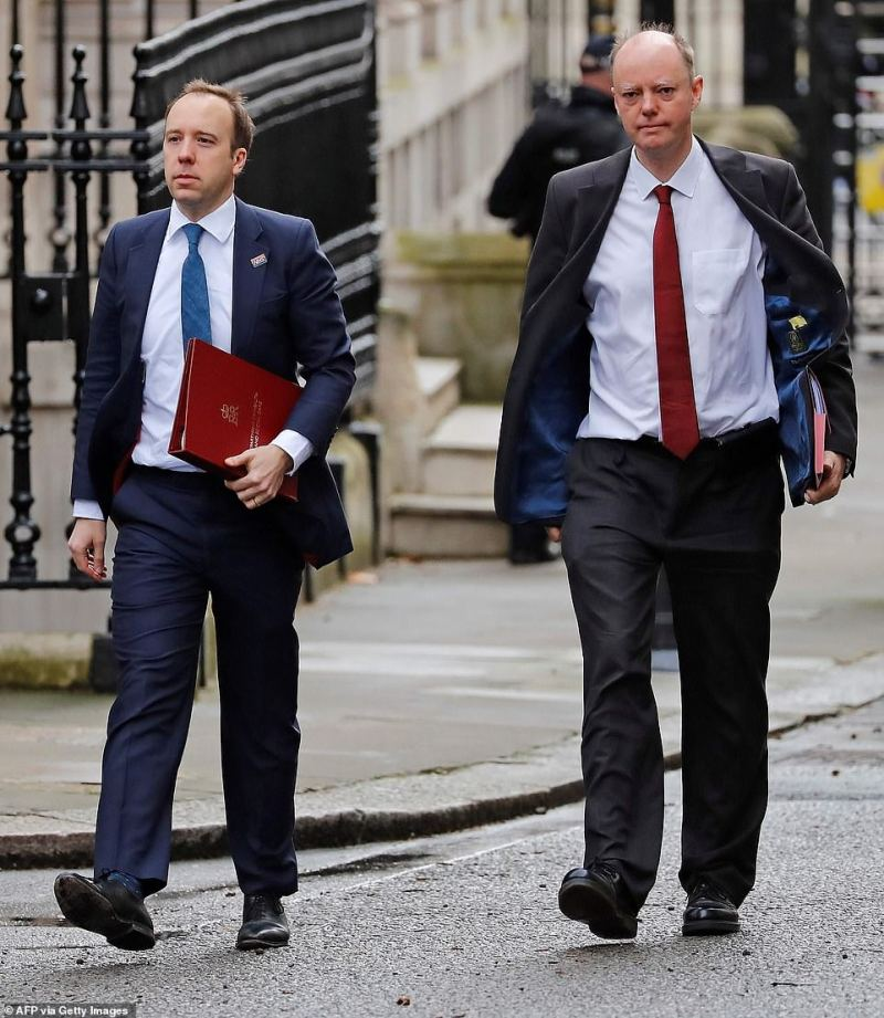 Britain's Health Secretary Matt Hancock (left) arrives at Downing Street in central London this morning with Chris Whitty, Chief Medical Officer for England, for an emergency Cobra meeting