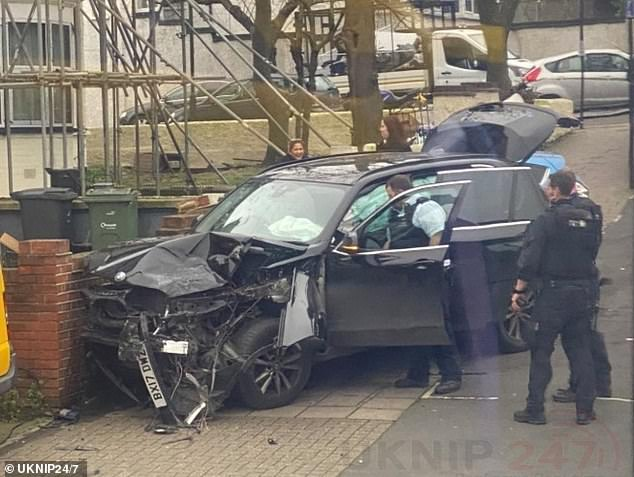 One of the officers, who was driving an unmarked police car, was involved in a crash with two other vehicles while on his way to the attack, resulting in two injuries