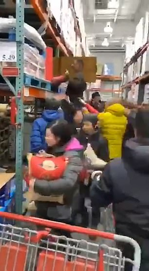 Shoppers stocking up on food in Queens