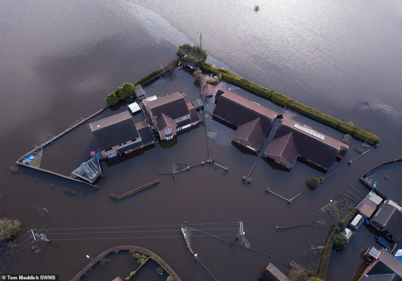 Shocking images from above Snaith today show homes deeply submerged by flood water after what the Met Office said was the wettest February on record