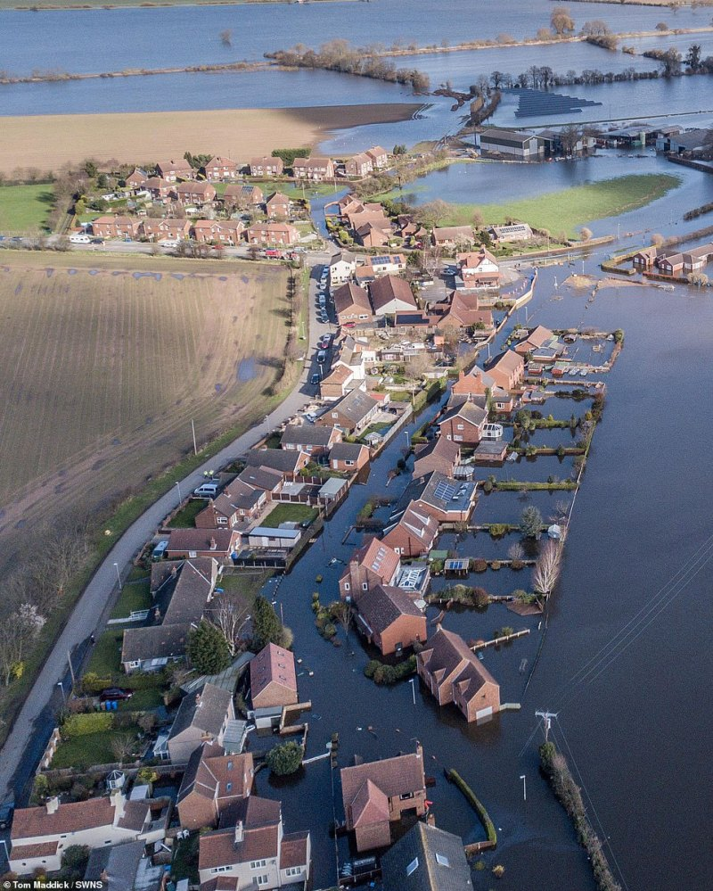 A photograph taken today over East Cowick in East Yorkshire, which neighbours Snaith, shows how the communities have been overwhelmed by floodwater, with about 88 properties deluged