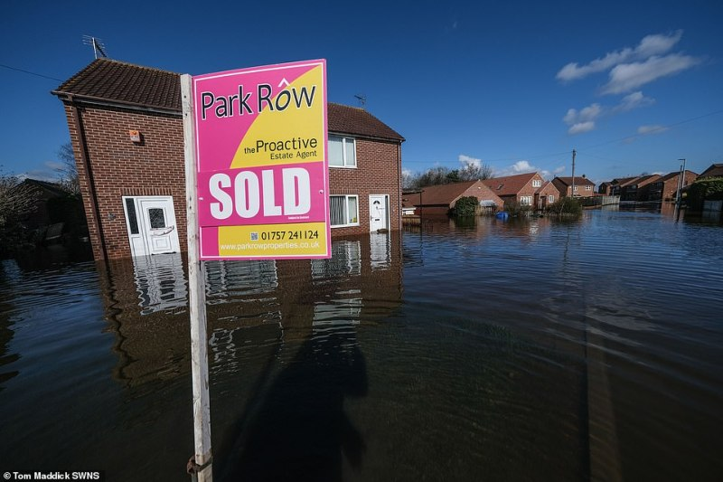 A photograph taken today in Snaith shows a home recently sold that has flooded after widespread deluges over the past month in East Yorkshire