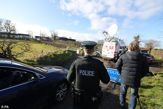 Police set up a checkpoint to the entrance to a property in Bankhall Road, Larne on Monday