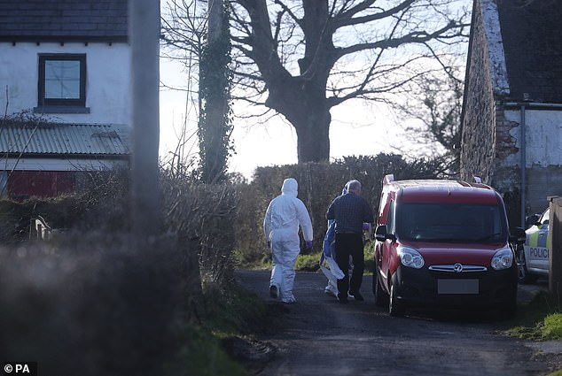 Forensic officers at the scene of a major incident at a farmhouse in Bankhall Road, Larne on Monday