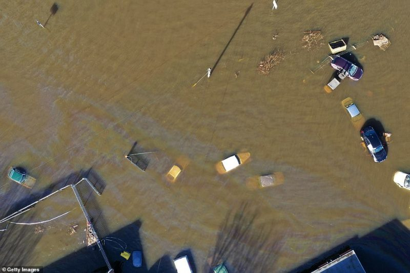 An aerial photograph taken today over Snaith shows several vehicles completely swallowed up by floodwater after the River Aire burst its banks