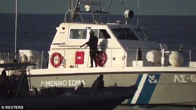 Occupants of the boat can be heard screaming as their rubber dingy endures rough waves and is sandwiched between Greek coastguard's larger dingy and a 50ft coastguard vessel