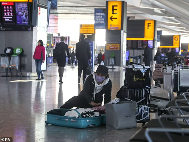 Most of BA's cancellations are for short-haul flights between Heathrow and Italy, France, Austria, Belgium, Germany, Ireland and Switzerland. Pictured: A woman wearing a face mask at Terminal 5 at Heathrow Airport