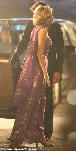Glamorous: Emma looked radiant in the floor length frock teamed with a matching neck-tie which she wore draped down her back