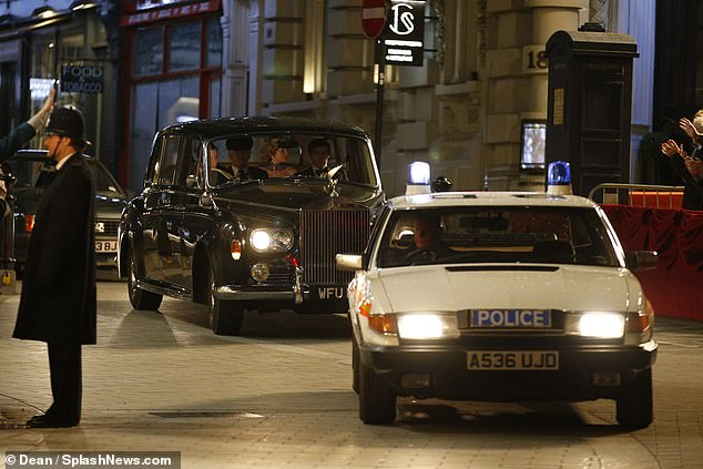 Making an entrance: An old fashioned police car led the way for the actors' car