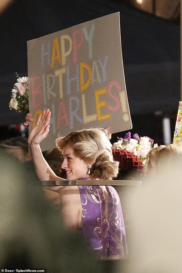 It's a sign: The crowds held up Happy Birthday signs for the future king
