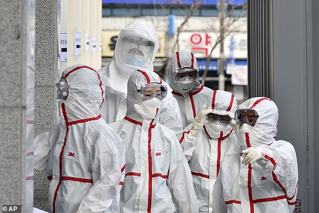 Twitter has told all of its 5,000 employees around the world to work from home in an effort to stop the spread of the deadly coronavirus epidemic. Pictured:Medical staff in protective gear arrive for a shift at Dongsan Hospital in Daegu, South Korea today