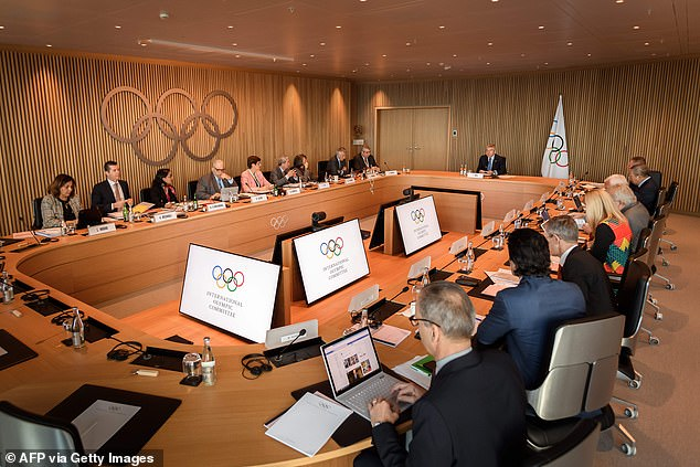 International Olympic Committee members hold a meeting in Lausanne, Switzerland, today. The IOC has insurance in case of a cancelled Games