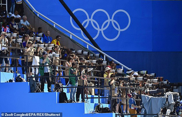 Media photographers take pictures during the Rio 2016 Olympics four years ago, with broadcasters paying huge sums to cover the Games