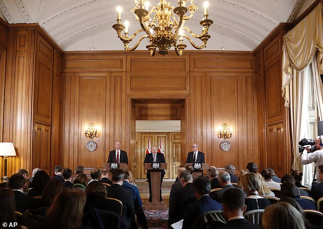 The advice came as Prof Whitty took questions at a press conference alongside Boris Johnson (centre) and UK chief scientific officer Sir Patrick Vallance (right)