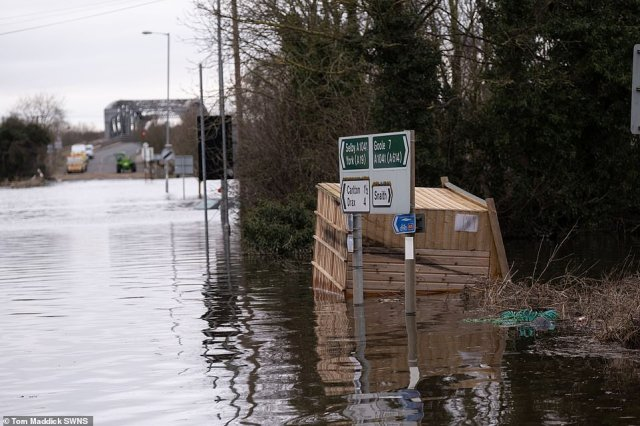 A shed floods on its side following severe flooding in the village of Snaith in East Yorkshire today
