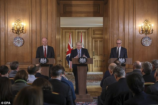 Mr Johnson was flanked by England's chief medical officer Professor Chris Whitty and chief scientific adviser to the Government Sir Patrick Vallance today in Downing Street