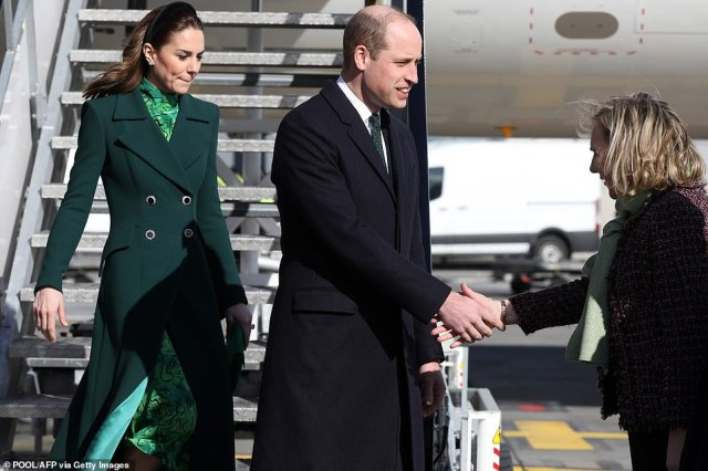 The Duke of Cambridge shakes hands with a dignitary after he and Kate touched down at a sunny Dublin Airport this afternoon