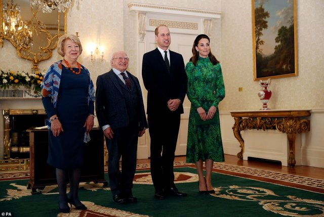 The couple beamed as they stood for an official portrait with President Higgins and his wife in the grand drawing room of the official residence