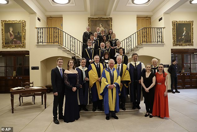 Prince Charles posing for a group photograph with award winners at the Royal College of Music's annual awards in London