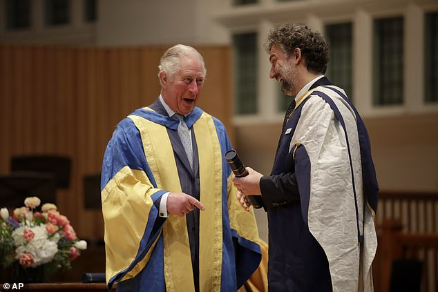 The Prince of Wales presents German operatic tenor Jonas Kaufmann with an honorary Doctor of Music award at the Royal College of Music's annual awards in London