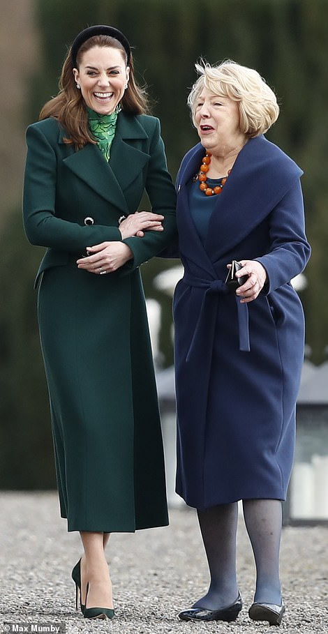 The Duchess of Cambridge walked arm-in-arm with the President's wife, Sabina Higgins, as they walked through the gardens of his official residence today