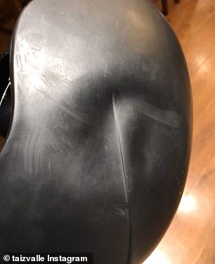 A picture posted later showed a large dent in her helmet