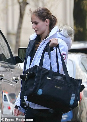 Shuliak leaving Epstein's home in early 2016 with a puppy carrier
