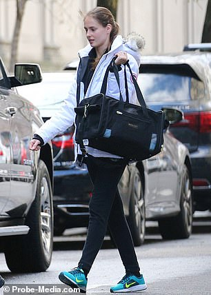 A photograph from January that year shows her leaving Epstein's $75 million New York City mansion in a white jacket and blue jeans
