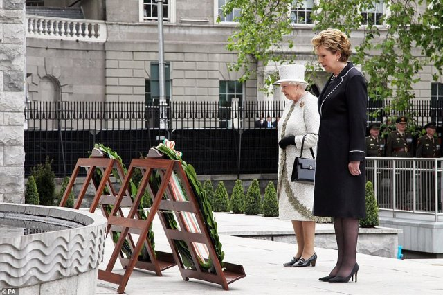 Queen Elizabeth II and President Mary McAleese during a wreath laying ceremony at the Garden of Remembrance in Parnell Square, Dublin on the first day of her State Visit to Ireland, in May 2011