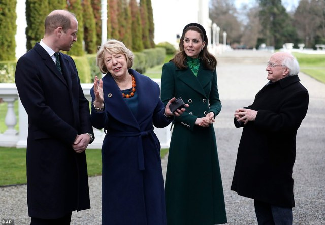 The royal visit - the couple's first to Ireland - was made at the request of Britain's Foreign Office to 'highlight the many strong links between the UK and Ireland,' Kensington Palace said (pictured, Prince William, left, and Kate, Duchess of Cambridge, second right, walk with Irish President Michael Higgins and his wife Sabina)