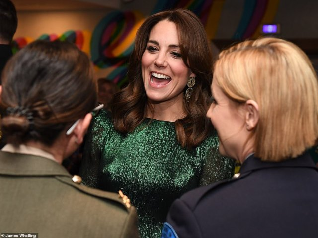 William and Kate were said to be looking forward to building a lasting friendship with the Irish people during their first official visit to the country (Kate is pictured meeting guests at the Guinness Storehouse Gravity Bar this evening)