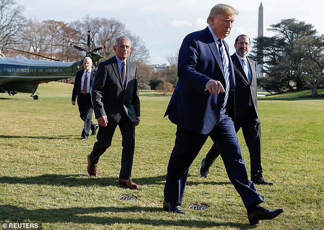 President Donald Trump is followed by Anthony Fauci, director of National Institute of Allergy and Infectious Diseases, and Health and Human Services (HHS) Secretary Alex Azar as they return to the White House from a coronavirus briefing