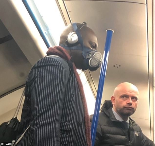 This London commuter took to the Tube in a fully kitted out face mask in a colour to match his suave pinstripe suit. His fellow passenger seems to be less than impressed by the ensemble